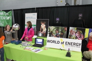 Mikayla Kreuzberger, with the World of Energy demonstrates the Van De Graaff generator to a student at the Duke Energy Invention Convention