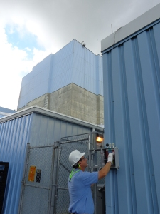 Ted Smith, Lead Safety Professional at Brunswick Nuclear Plant, verifies correct operation of heat stress monitors to ensure worker safety in hot environments.