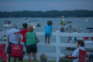 A young guest enjoys the view while listening to the sounds of the Charlotte Symphony at McGuire Nuclear Station.