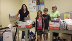 WIN teammates from Oconee Nuclear Station help distribute school supplies.