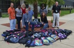 Catawba Nuclear Station's procurement team purchased a total of 84 book bags with donations totaling more than $750.