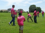 Pen pals play football on the lawn of the EnergyExplorium, McGuire's energy education center.