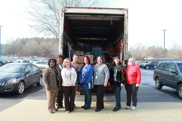 WiN members and Oconee Nuclear Station volunteers pack toys Dec. 16, for 400 children into the Salvation Army truck.