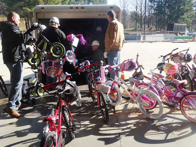Mecklenberg County's McGuire Nuclear Station employees recently load 197 children's bikes for Toys for Tots.