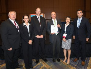 Duke Energy ECM Program team accepting the Vision, Leadership & Ingenuity Award (Photo credit: NEI)