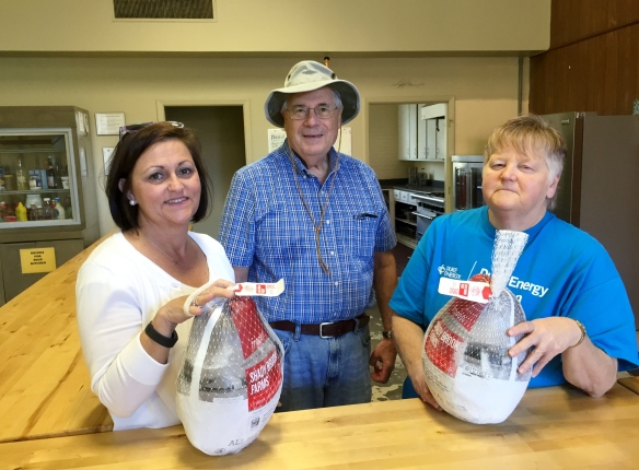Robinson Nuclear Plant employees present the Hartsville Soup Kitchen with donated turkeys.