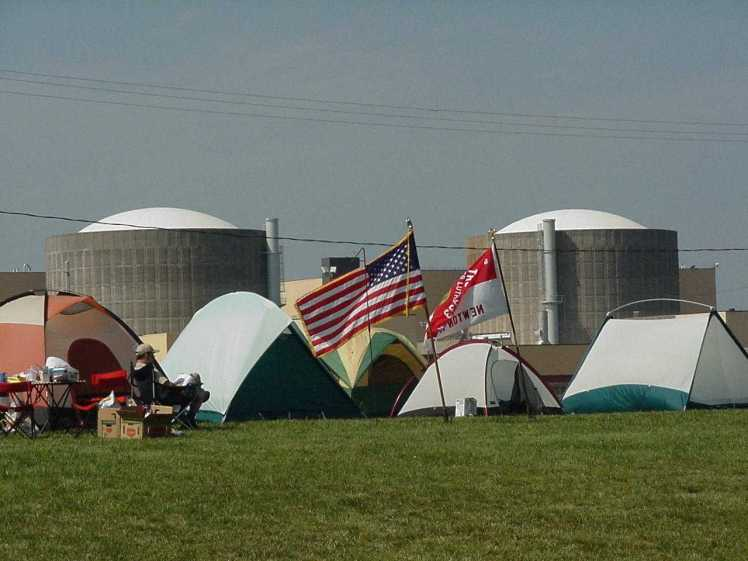 A tent with a view: scouts pitched tents on the lawn at McGuire Nuclear Station for the 1999 encampment.