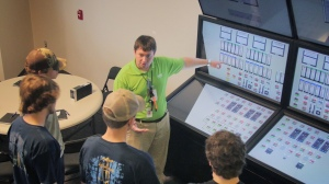 Area students learn about the control room on this glass top simulator.