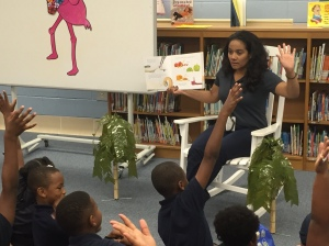 Robinson Nuclear team member Celia Thompson reads to children at Bishopville Elementary.
